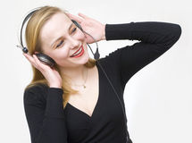 Listens to the sounds Stock Images