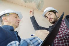 Listing areas defects in building. Listing the areas of defects in the building Stock Photography