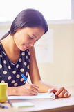 Listing her duties for the day Royalty Free Stock Photo