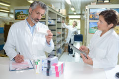Listing out date medicines. Listing the out of date medicines Royalty Free Stock Photo
