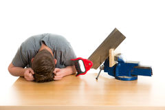 Listless teenager in professional training with saw Stock Photo