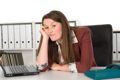 Listless young woman. In office Royalty Free Stock Images