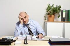 Listlessly businessman at desk Stock Photography