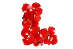 Listowy L robić od czerwonych róż płatków Fotografia Stock