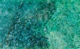 Listvenit mineral stone texture patter. Metasomatic rock consisting of carbonates ankerite, quartz and muscovite. Fuchsite. Green color stony background Royalty Free Stock Images