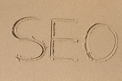 Listy S E O rysujący w piasku fotografia royalty free