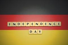 Listy z teksta dniem niepodległości na flaga państowowa Germany Obraz Royalty Free