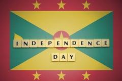 Listy z teksta dniem niepodległości na flaga państowowa Grenada Obraz Stock