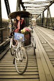 Lisu Hill tribe girl on tricycle bike taxi Stock Photography