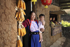 Lisu Hill tribe women at earthen house Stock Photography