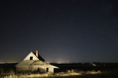 Lit Abandoned Ranch House Stock Photo