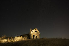 Lit Abandoned Ranch House Stock Images