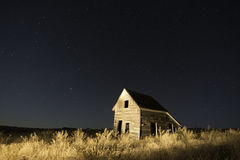 Lit Abandoned Ranch House Stock Image