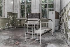 Lit abandonné d'enfants Photographie stock