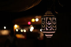 Lit Arabic lamp at night, background lights Royalty Free Stock Images