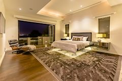 Lit bedroom of luxury California home upstairs penthouse stock images