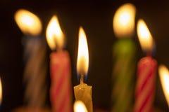 Lit Birthday candles with dark background.  Stock Photo