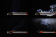 Lit and burning cigarette with smoke. On black background Royalty Free Stock Photo