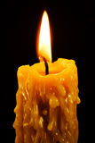 Lit candle on black Stock Photos