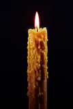 Lit candle on black Royalty Free Stock Image