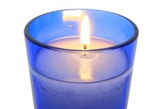 Lit Candle In Blue Glass Close Up Stock Image