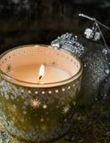 Lit candle and christmas ball Royalty Free Stock Photos