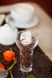 Lit Candle On Coffee Beans In Holder Royalty Free Stock Photography