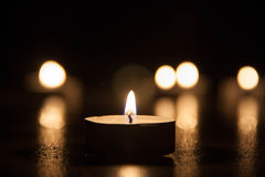 Lit Candle on the flor Royalty Free Stock Image