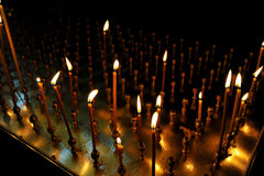 Lit candle inside of an Orthodox Church Royalty Free Stock Image