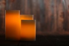 Lit Candle on an Old Wooden Rustic Background Stock Image