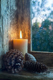 Lit candle and pine cones Royalty Free Stock Photos