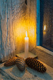 Lit candle and pine cones Royalty Free Stock Photo