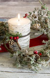Lit candle and a stick of cranberries Royalty Free Stock Image