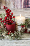 Lit candle and a stick of cranberries Royalty Free Stock Photography