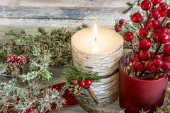 Lit candle and a stick of cranberries Royalty Free Stock Images