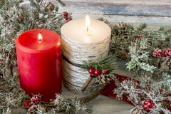 Lit candle and a stick of cranberries Royalty Free Stock Photo