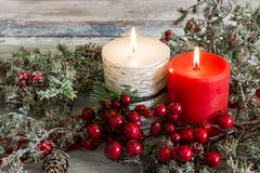 Lit candle and a stick of cranberries Stock Photography