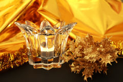 Lit candle in a transparent glass candlestick Royalty Free Stock Photos