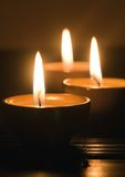 Lit candles Stock Images