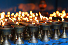 Lit candles. Lit traditional candles with dark background in Nepal Royalty Free Stock Photo