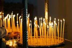 Lit candles in candlestick at church royalty free stock photography