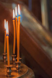 The lit candles in church against Royalty Free Stock Image