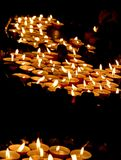 Lit candles in a church during the funeral celebration Stock Photo