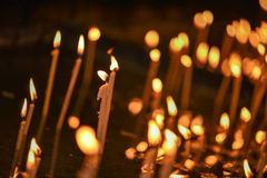 Lit candles in a church Stock Images