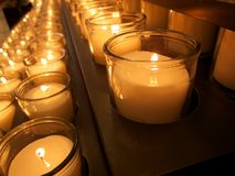Lit Candles in a church Stock Image