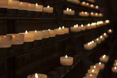 Lit candles in church Stock Photography