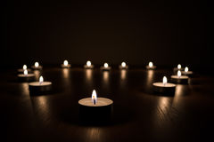 Lit Candles in the Dark Stock Image