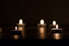 Lit Candles in the Dark Royalty Free Stock Images