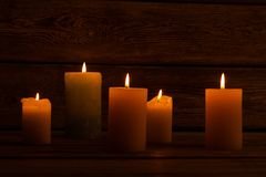 Lit candles in dark room Stock Images