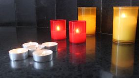 Lit candles stock video footage
